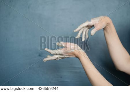 Female Hands Clotted Mud Clay Play Cheerfully And Show Hands. Hands Dirty