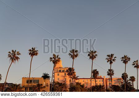 Clear Sky Above City. Scenic View Of Tropical City. Townhouses And Palm Trees. Urban Landscape