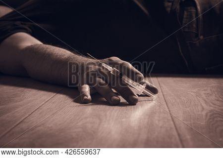 Addictive Miserable Man On The Floor With Syringe