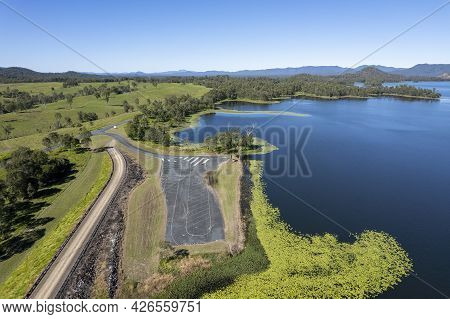 Aerial Over Teemburra Dam Australia Boat Ramp Car Park And Rock Wall, Showing Water Expanse