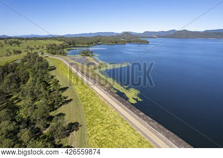 Aerial Over Teemburra Dam Australia Showing Rock Wall And Water Expanse