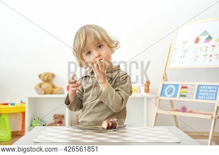 Cute Happy Child Boy Having Fun Eating Chocolate Cake At Home. Chocolate, Sweets And Sugar, Unhealth