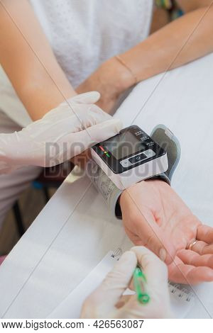A Girl Doctor Measures The Blood Pressure Of An Adult Woman. The Patient Asked For Help With High Bl