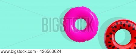 Inflatable Swimming Pool Ring On Blue Background.
