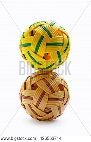 Two Rattan Balls On A White Background.