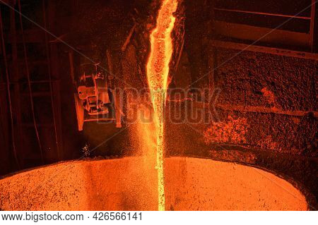 A Stream Of Molten Slag Is Poured Into A Metallurgical Ladle.