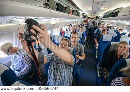 Switzerland - 05.29.2015 - Passengers And Journalists On Board, A Blue Seats, Flight.