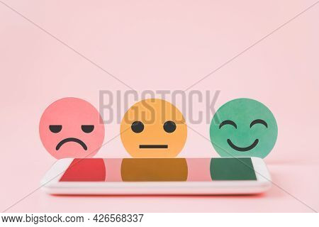 Emotion Paper Cut Behind Blurred Mobile Phone For Mental Health Assessment ,positive Thinking, Custo