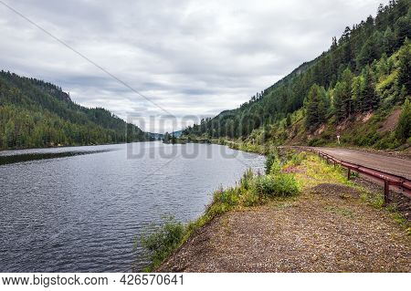 Cheybekkel Mountain Lake Is Surrounded By Mountains And Coniferous Taiga. Ulagan District Of The Alt