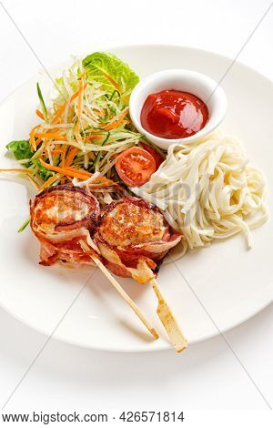 meatballs with noodle and salad