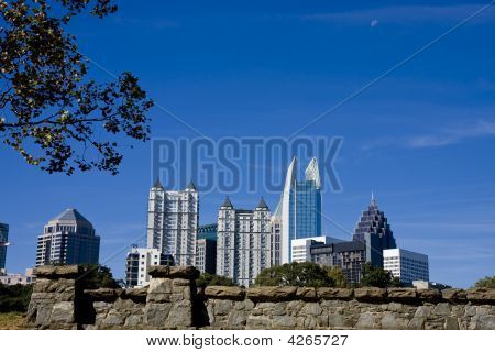 City Skyline Past Stone Wall