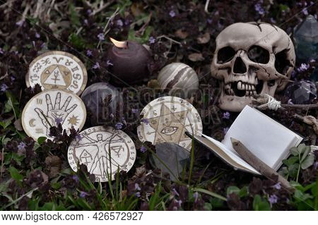 Grunge Still Life Wil Skull, Crystal, Burning Candle, Book And Magic Ritual Objects Outside. Esoteri