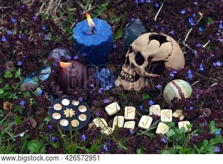 Beltane Still Life With Skull, Burning Candles, Witch Ritual Objects And Runes Outside. Esoteric, Go