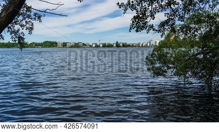 Idyllic View Over Lake Ziegelsee In Schwerin With Appartment Buildings On The Other Lakeshore