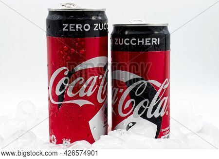Bologna - Italy - July 12, 2021: Cans Of Coca Cola On Ice With Water Droplets.