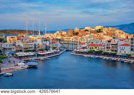 Beautiful Agios Nikolaos town on lake Voulismeni on sunset. Lasithi region of Crete island, Greece