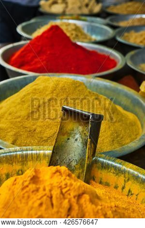 Turmeric curcuma powder and chili powder in spices market in India. Sardar Market, Jodhpur, Rajasthan, India