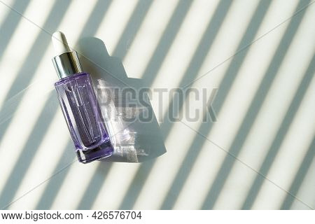 Anti Aging Serum With Collagen And Peptides In Glass Bottle With Dropper On White Background With Sh
