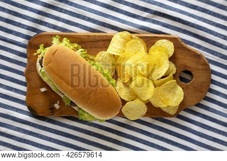 Homemade Chopped Beef Sandwich With Potato Chips On A Rustic Wooden Board, Top View. Flat Lay, Overh