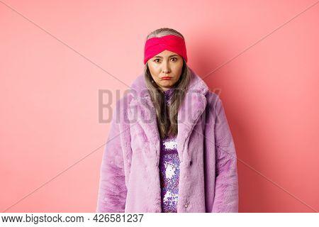 Sad And Gloomy Stylish Asian Senior Woman Looking Upset At Camera, Sulking And Feeling Distressed, S