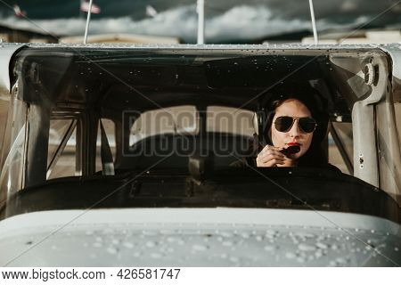Aviator with headphones listening to the air traffic