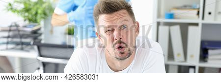 Surprised Man Undergoes Medical Examination By Proctologist