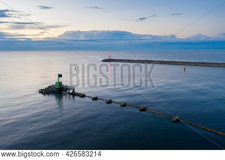 Baltic Sea at the East Breakwater in Gdansk at dusk, Poland