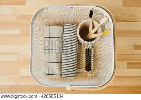 View of basket with natural and eco friendly bodycare items on wooden table