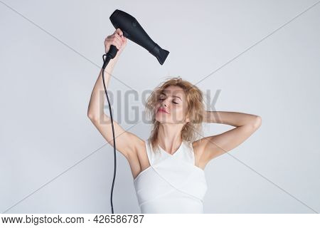 Women Hair Treatment. Beautiful Girl Using A Hair Dryer, Hairdryer. Young Woman With Drying Hair Wit