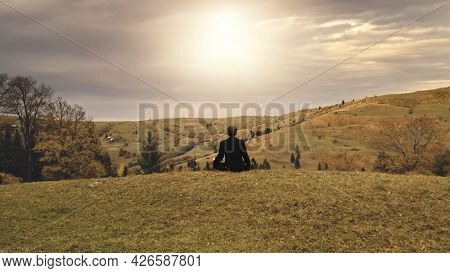 Sun mountain top aerial. Business man relax. Autumn nature landscape. Recreation vacation at green grass valley at sunny day. Travel and tourism scenery. Carpathians mounts, Ukraine, Europe