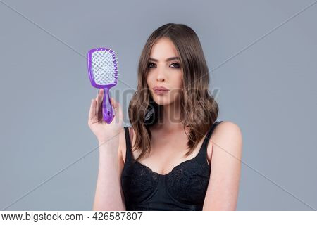 Young Beautiful Woman Combing Hair. Hair Care. Beautiful Brunette Woman Hairbrushing Hair With Hairb