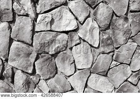 Black And White Background Of A Stone Wall.the Walls Are Made By Hand From Concrete And Stone, As Th