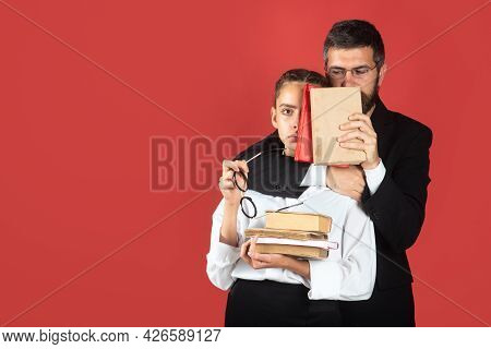 Girl Student With Pile Of Books. Hard To Study. Portrait Of Funny Teacher And Young Student Teen Gir