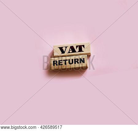 Vat Return Text Value Added Tax Return On Wooden Blocks On Pink Background. Financial Concept