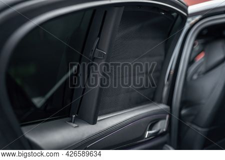 Car Rear Window Side Curtain. Sunblind Curtain In A Modern Luxury Car. Selective Focus.