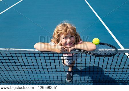Little Boy Playing Tennis. Sport Kids, Thumbs Up, Winner. Child With Tennis Racket On Tennis Court.