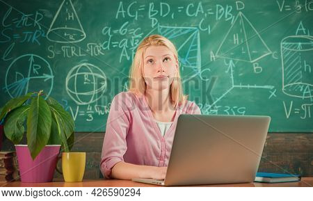 Woman Teaching In Classroom At School Or University Use Laptop. Happy Woman Student Teach And Learn.