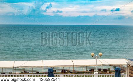 The Roof Of The Canopy Over The Sun Loungers On The Beach Against The Sea
