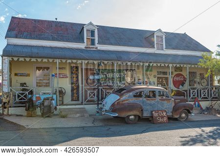 Prince Albert, South Africa - April 20, 2021: A Street Scene, With The Olde Shoppe, An Antique Shop,