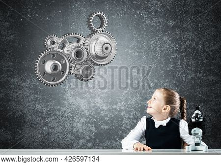 Little Girl Scientist With Microscope On Chalkboard Background With Gears Mechanism. Research And Di