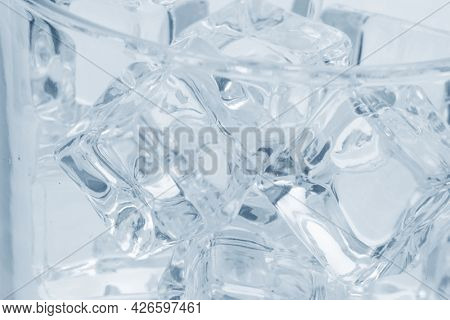 glass with ice cubes closeup