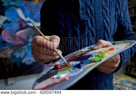 painter in the studio with brush