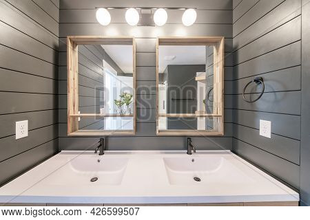 Alcove Double Sink With Ambient Lightnings And Gray Walls With Horizontal Line Design