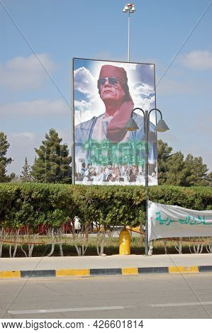 Tripoli, Libya - March 26, 2006: Giant Poster Of The Dictator Colonel Gaddafi Looming Over The Entra