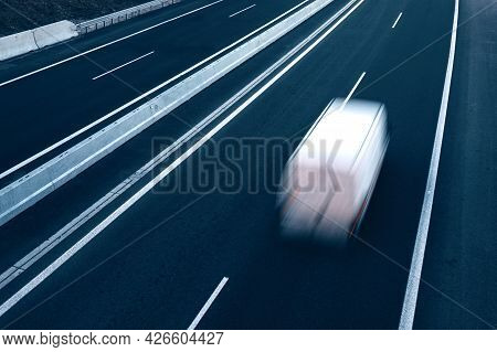 Fast Moving Blurry Cars Driving On The Highway