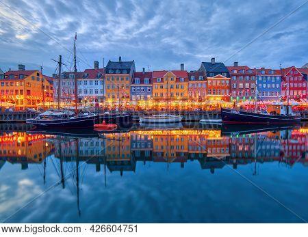 Copenhagen, Denmark - July 02, 2021: Copenhagen Iconic View. Famous Old Nyhavn Port In The Center Of