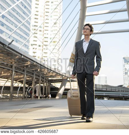 Asian Businessman Wear Suit, Eye Glasses Standing Street In Modern City. Portrait Young Handsome Asi