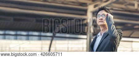 Banner Asian Businessman Wear Suit, Eye Glasses Standing Street In Modern City. Portrait Young Hands