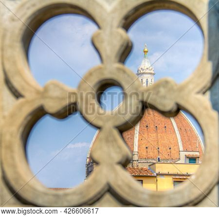 Duomo Santa Maria Del Fiore Dome Behind An Ornate Balcony In Florence In Tuscany, Italy