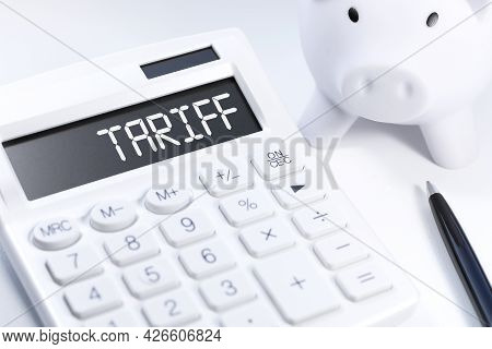 Word Tariff On Calculator. Business Concept On White Background. Top View.